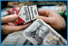picture of ten pound note and cigarette pack transaction